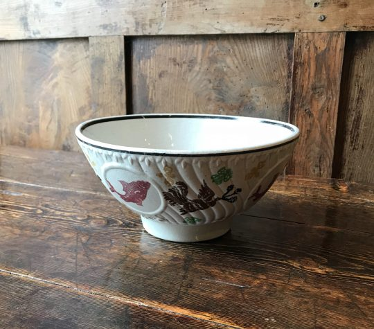 Spongeware bowl decorated with fish Sold
