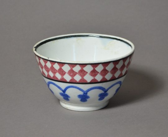A small bright sponge decorated Staffordshire bowl Sold