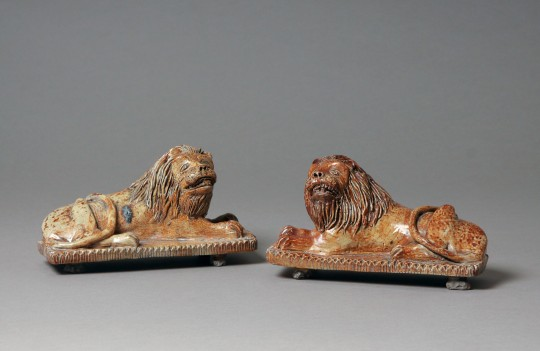 Pair of pottery lions (on hold)