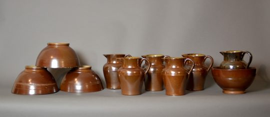 A group of brown stoneware pottery jugs & bowls