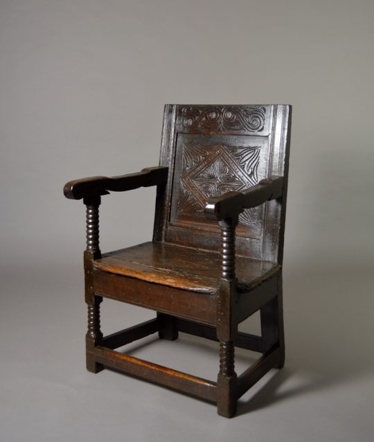 Carved 17th century armchair