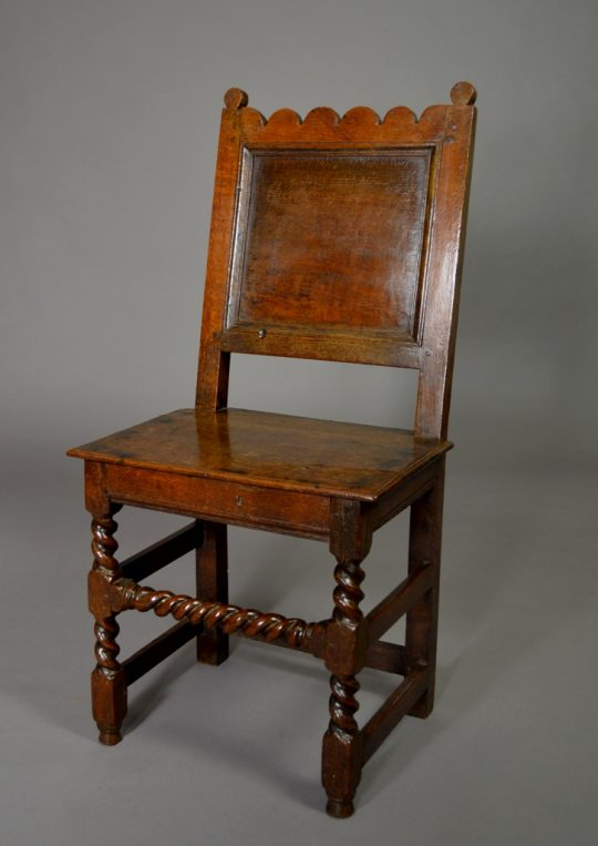 Panelled oak chair Sold