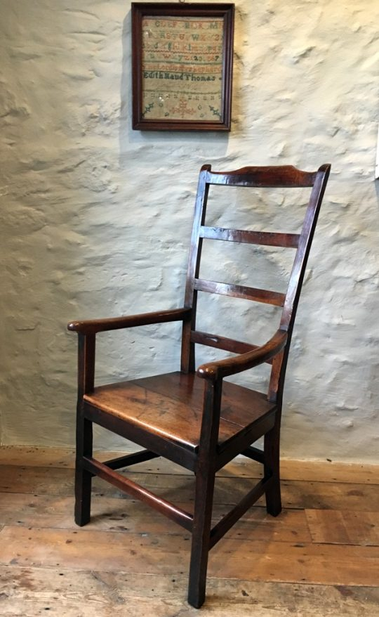 Walnut ladder-back armchair Sold